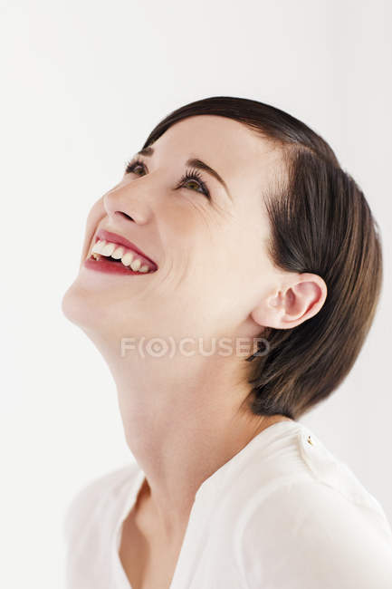 Close up portrait of smiling woman with head back — Stock Photo