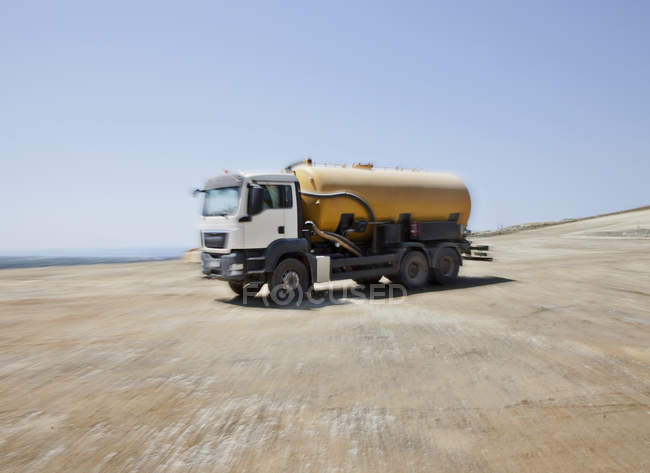 Blurred view of truck in quarry — Stock Photo