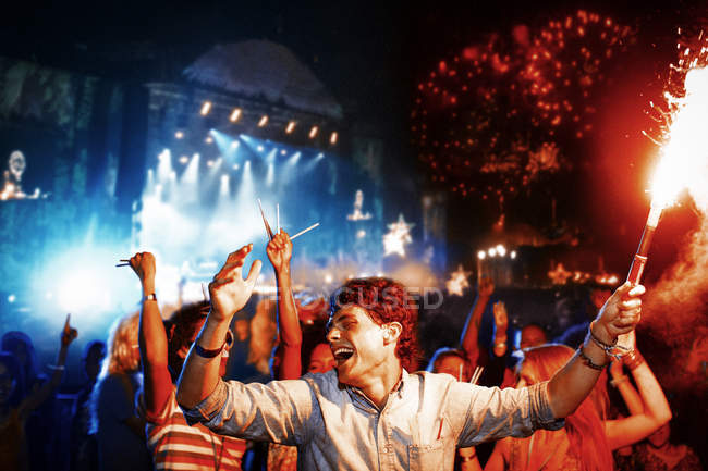 Fans with fireworks at music festival — Stock Photo