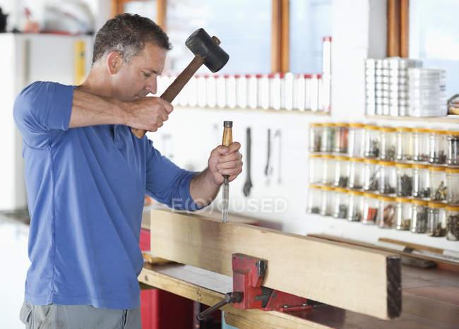 Skillful caucasian man working in workshop — Stock Photo