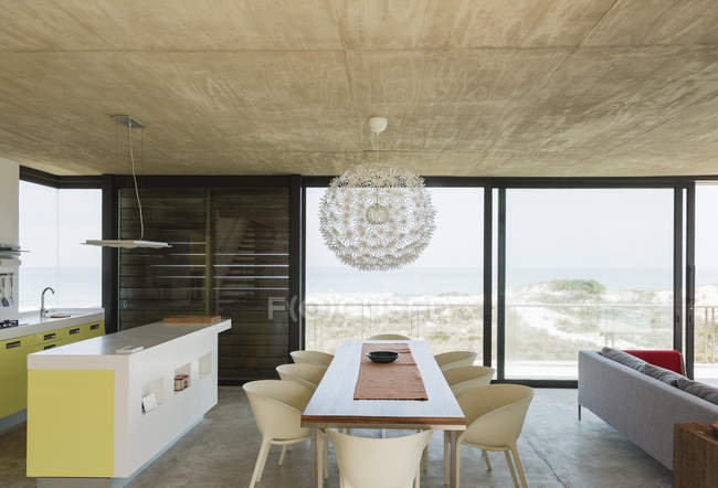 Dining room and kitchen overlooking ocean — Stock Photo