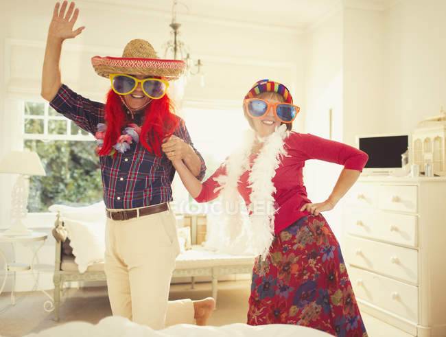 Portrait silly mature couple dancing in costumes — Stock Photo