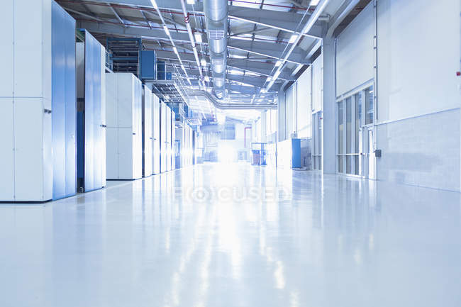 Sunny factory corridor indoors — Stock Photo