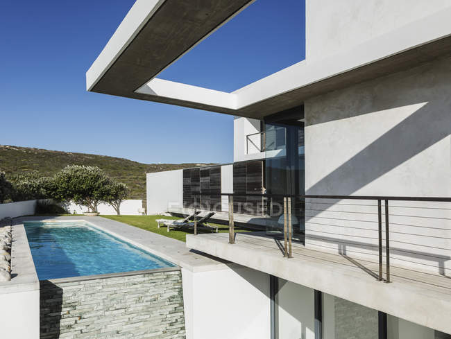 Balcony and lap pool of modern house — Stock Photo