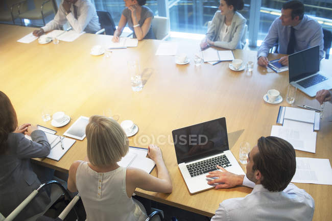 Business people sitting in meeting — Stock Photo