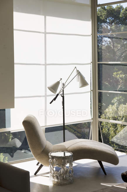 Chaise by window  indoors during daytime — Stock Photo
