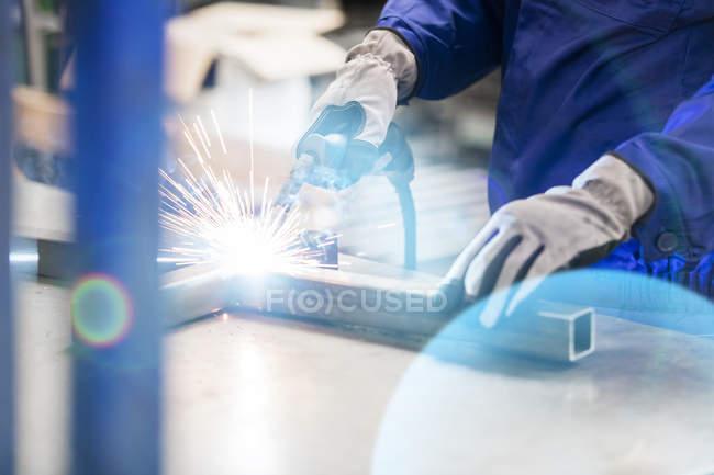 Welder welding steel in factory — Stock Photo