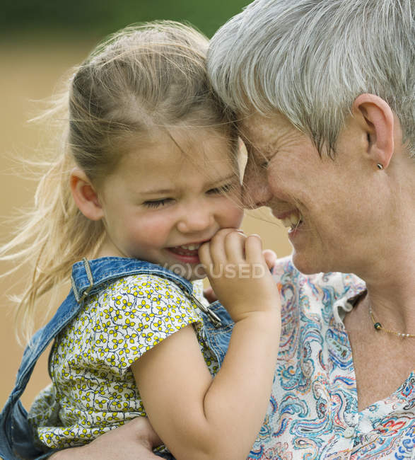 Close up grandmother and granddaughter hugging — Stock Photo
