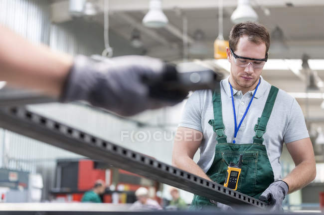 Worker in protective workwear in factory — Stock Photo