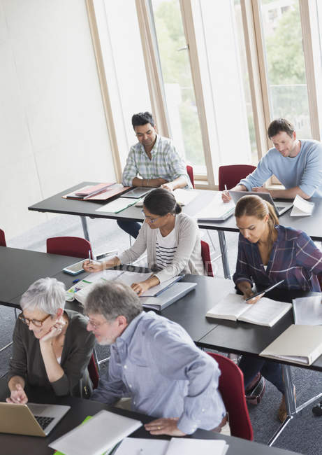 Students studying in adult education classroom — Stock Photo