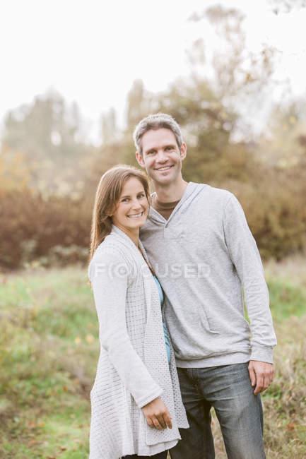 Portrait smiling couple in autumn park — Stock Photo