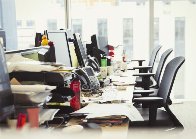 Messy row of desks in modern office — Stock Photo