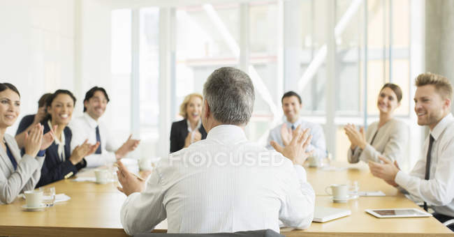Business people clapping in meeting — Stock Photo