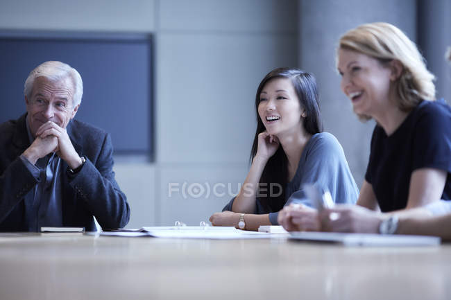 Businesswomen laughing in meeting — Stock Photo