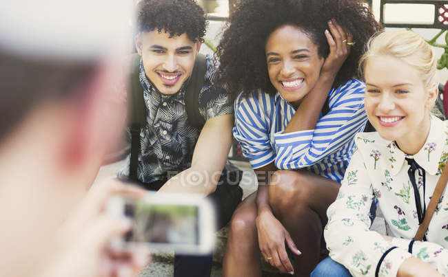 Enthusiastic friends being photographed — Stock Photo