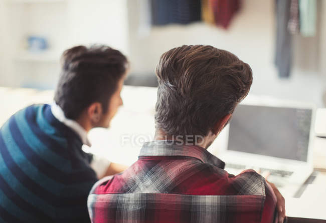 Creative young businessmen working at laptop — Stock Photo