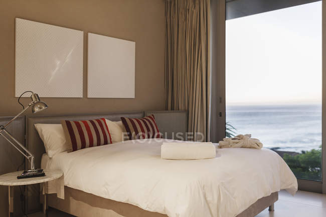 Modern bedroom interior with ocean view — Stock Photo