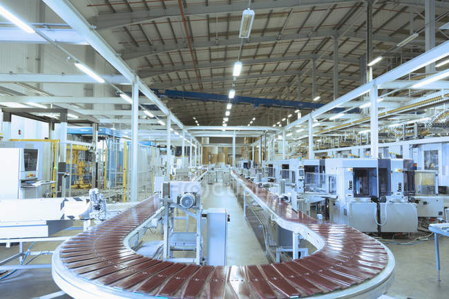 Conveyor belt and machinery in empty factory — Stock Photo