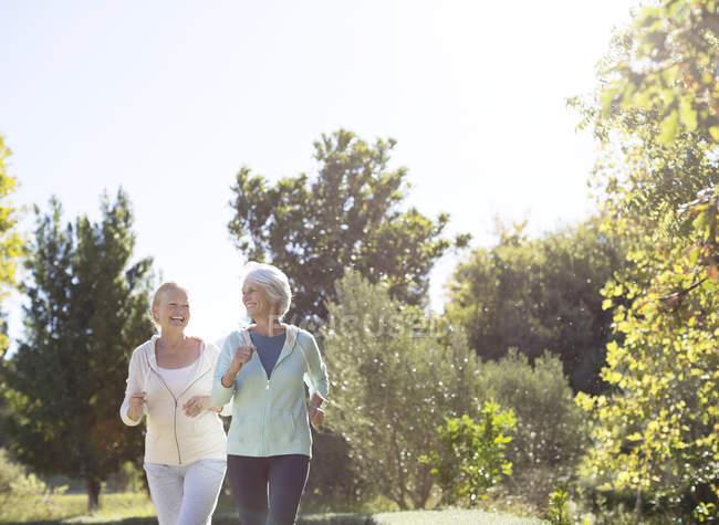 Senior women jogging in park — Stock Photo