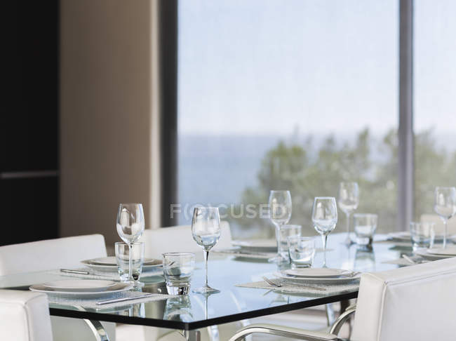 Set table in modern dining room interior — Stock Photo