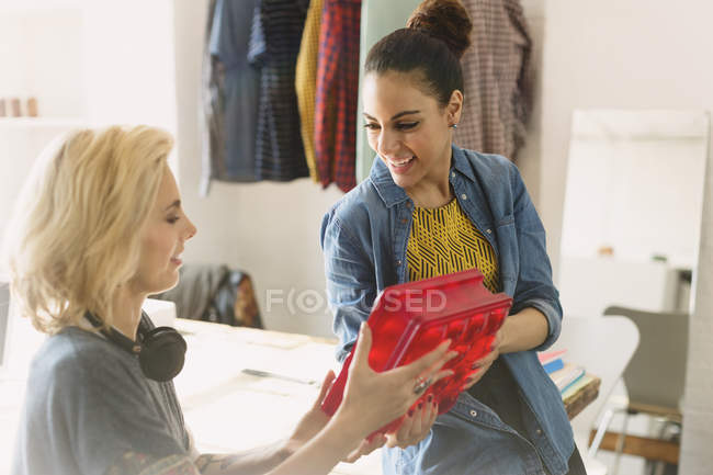 Innovative young businesswomen examining prototype in office — Stock Photo