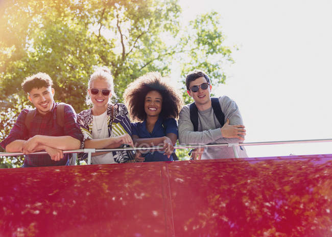 Portrait smiling friends riding double-decker bus — Stock Photo