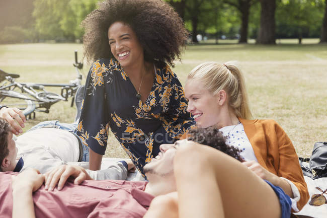 Friends hanging out relaxing in park — Stock Photo