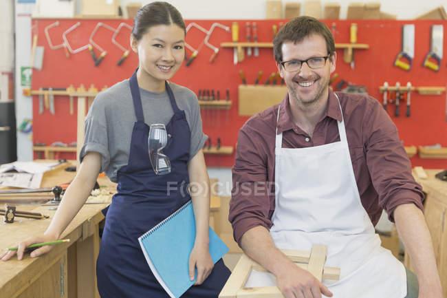 Portrait smiling carpenters in workshop — Stock Photo