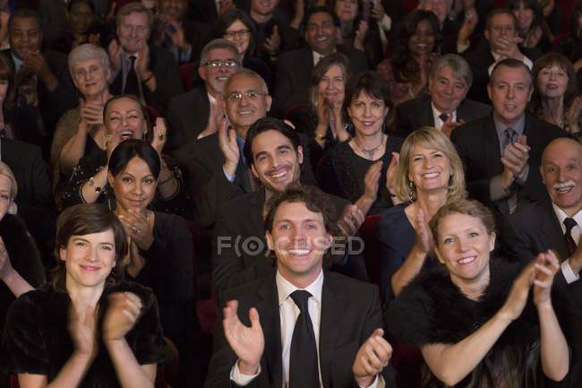 Clapping theater audience indoors — Stock Photo
