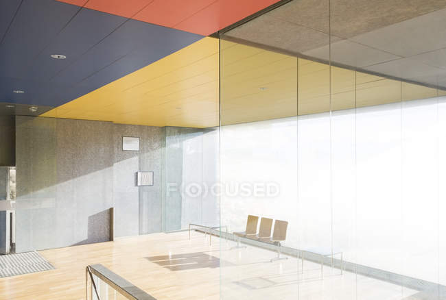 Chairs and window in sunny office lobby — Stock Photo