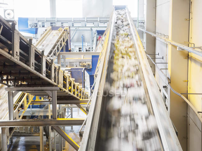 Recycling on conveyor belt in recycling center — Stock Photo