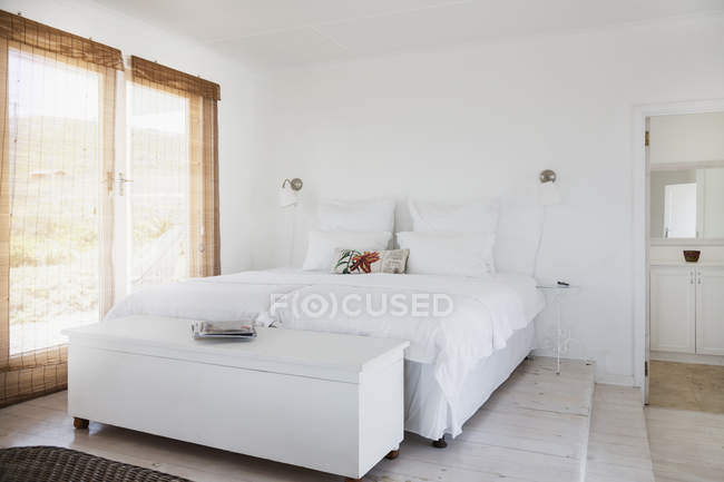 Cozy modern white bedroom interior — Stock Photo
