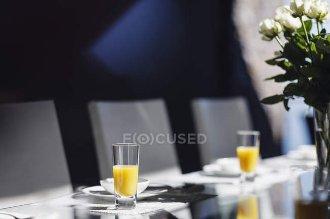 Mimosas on elegant dining table — Stock Photo