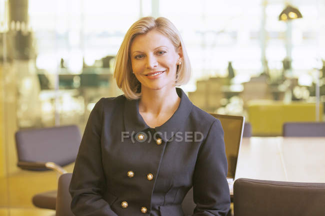Businesswoman smiling in office — Stock Photo
