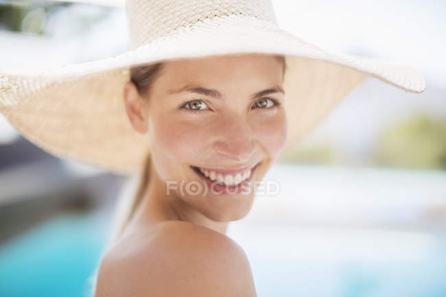 Portrait of smiling woman in sun hat — Stock Photo