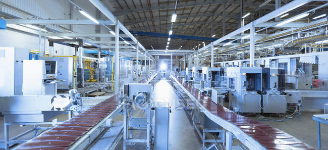 Conveyor belts and machinery in factory — Stock Photo