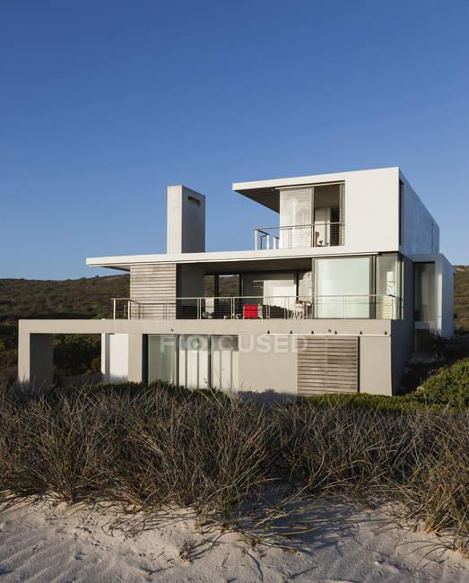 Modern house on beach — Stock Photo