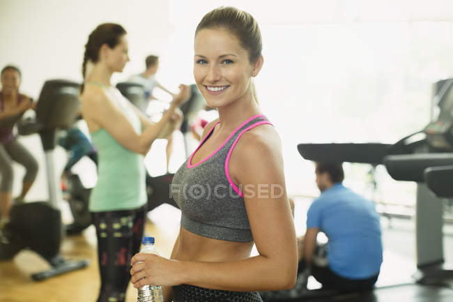 Portrait smiling woman resting at gym — Stock Photo