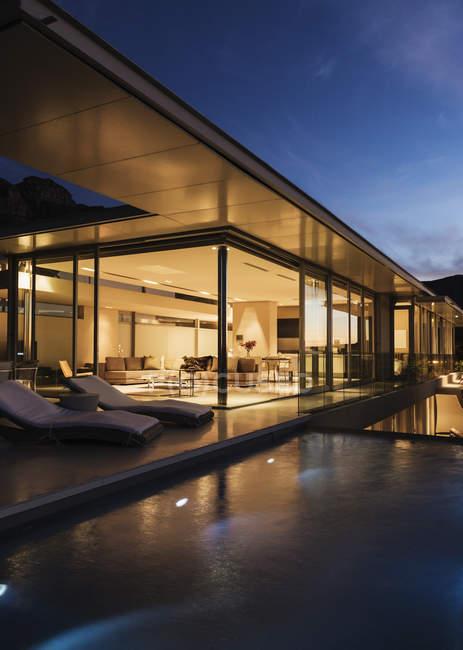 Modern house illuminated at night time — Stock Photo