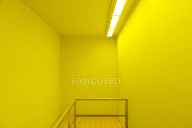 Banister in yellow room — Stock Photo