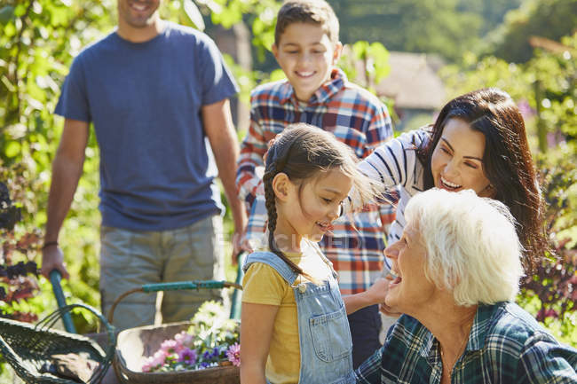Multi-generation family bonding in sunny garden — Stock Photo