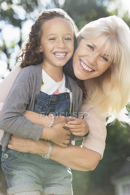 Portrait smiling grandmother and granddaughter hugging — Stock Photo