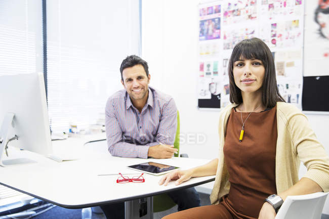 Portrait of smiling business people in office — Stock Photo