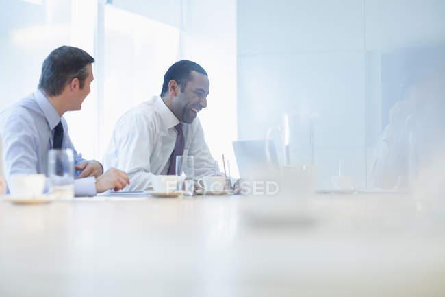Businessmen talking in meeting indoors — Stock Photo