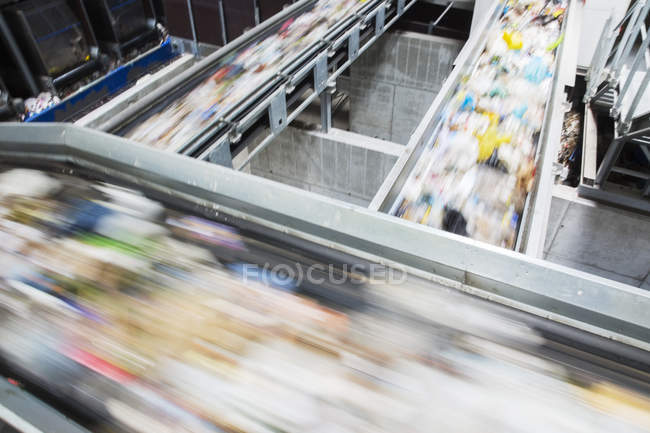 Blurred view of conveyor belts in recycling center — Stock Photo