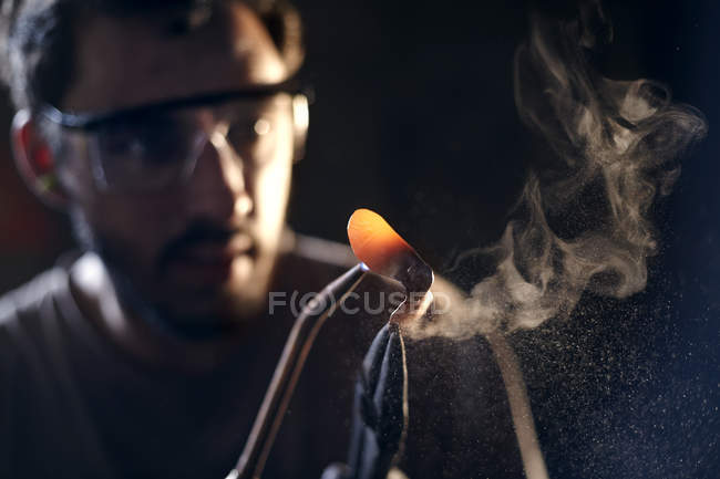 Close up of blacksmith shaping iron with blowtorch — Stock Photo