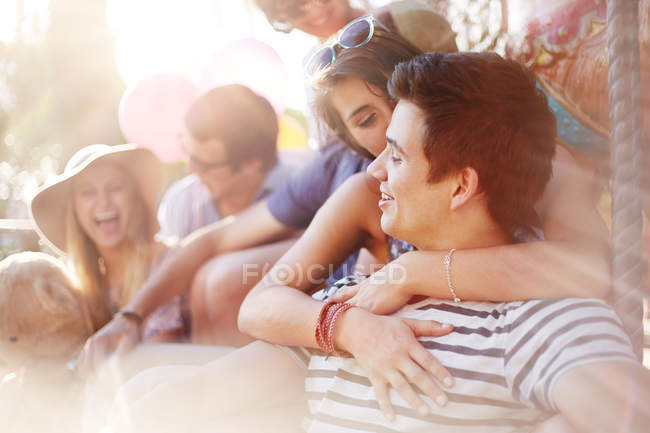 Young couple kissing summer outdoors — Stock Photo