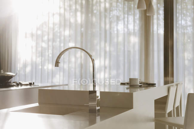 Faucet and sink in modern kitchen interior — Stock Photo