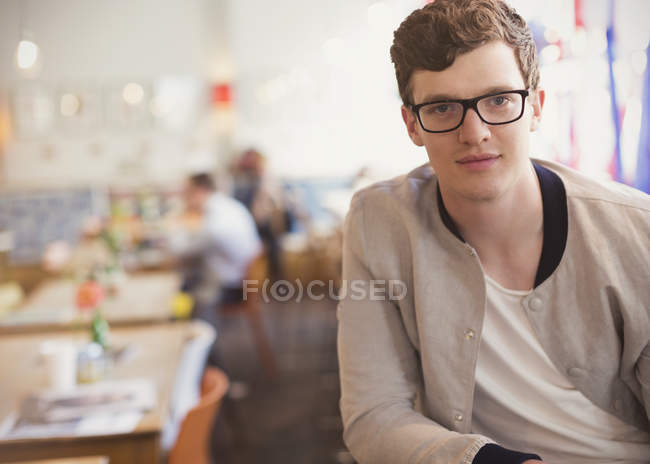 Portrait confident man with eyeglasses in cafe — Stock Photo