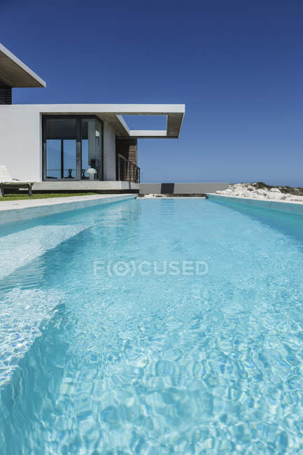 Scenic view of lap pool outside modern house — Stock Photo